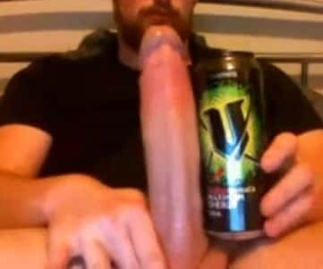 Bearded Man Compares His Big Monster Cock With Can Of Energetic
